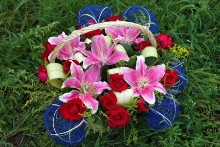 Basket of flowers on the lawn Stock Photo - 16288230