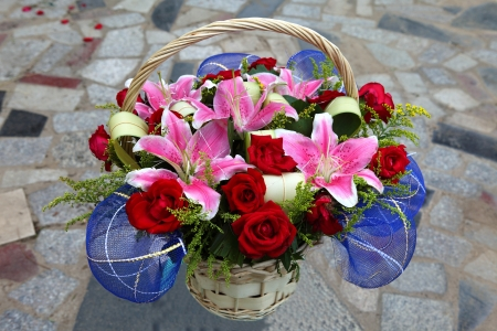 Basket of flowers on the stone photo
