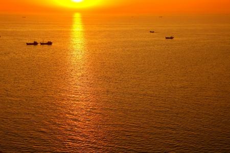 Sunrise at sea photo