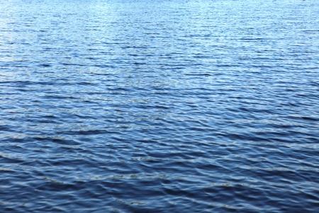 Rain drops at blue lake water surface Stock Photo - 16876652