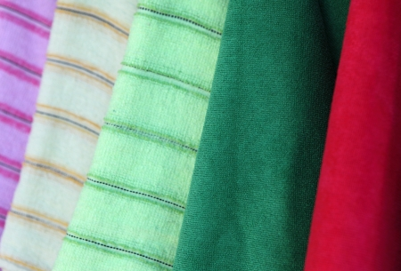 Colorful towels with ribbon on green background Stock Photo - 16905559