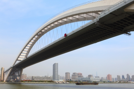 shanghai lupu bridge from across the huangpu river  photo