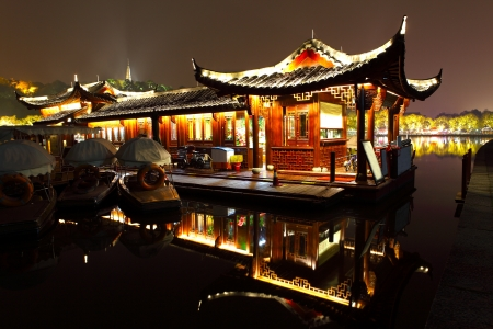 Scenery reflected in a quiet West lake at night   photo