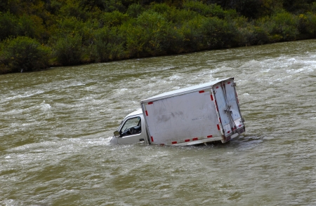 total loss: Damaged Car flooded in the river