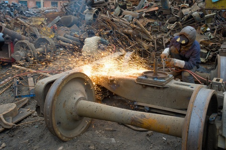 stone cutter: construction welder cutting steel on site Stock Photo