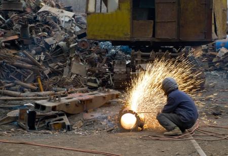 construction welder cutting steel on site