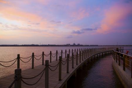 dusky sky and old wood bridge pier photo