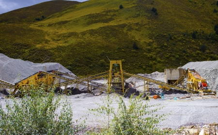 conveyors: Gravel pit and Belt conveyors in summer in front of cloudy blue sky after storm