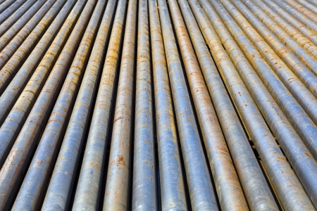depletion: Drill-pipe on Oil Rig Pipe Deck  Stock Photo