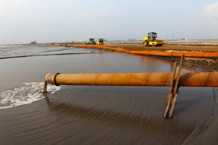 Reclamation for port purposes of land by dredging   Stock Photo