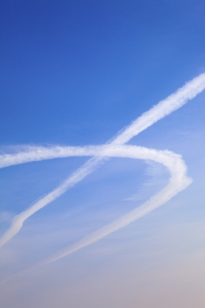 Jet of airplane in the blue sky photo