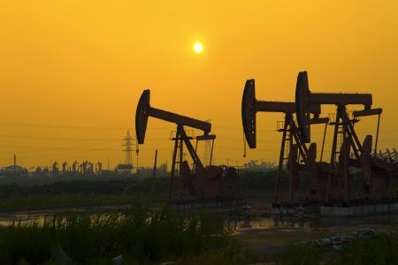 Oil Pump on orange sunset photo