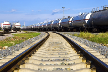 Tanks with fuel being transported by rail photo