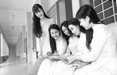 vietnamese ethnicity: Ho Chi Minh City, Vietnam - September 13rd, 2015: Group female students was studying lessons inside the school hallway in the morning at school Quang Trung, Ho Chi Minh City, Vietnam Editorial