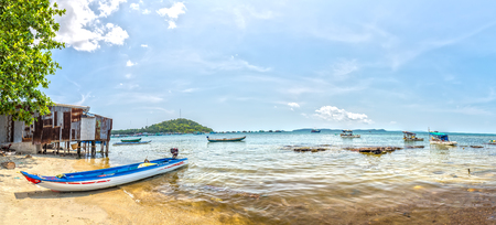 speedboats: Phu Quoc, Vietnam - April 10th, 2015: Boat canoe dock on clean sandy beaches fishing village with fishing boats and largest cultured pearls, distance permissive mountain beauty of bay create tourist island Phu Quoc, Vietnam
