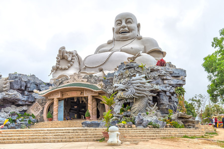 spiritual architecture: An Giang, Vietnam - April 12th, 2015: Architecture 34m high Maitreya Buddha biggest in Asia with a calm smile, compassion, amnesty Pedestal marble is beautiful architecture located on a high mountain where spiritual worship revered in An Giang, Vietnam Editorial
