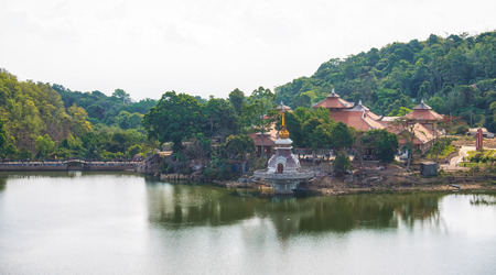 vietnamese ethnicity: An Giang, Vietnam - April 12th, 2015: Temple architecture with temple riverbank riverbank leads across the bridge to the Maitreya Buddha nearby, where beautiful temples concentrated around the large lake is where religion glass Buddha in An Giang, Vietnam