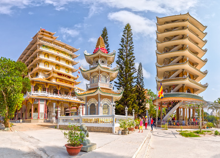 vietnamese ethnicity: An Giang, Vietnam - April 12th, 2015: Architecture Stupas on the temple with pattern definition pylon high roof symbolizes the supreme reverence, as well as cultural and architectural beauty of the countryside An Giang , Vietnam
