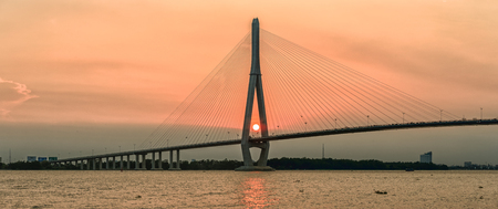 beauties: Can Tho, Vietnam - April 4th, 2015: Beauties of cable stayed bridge at sunset with the sun in the abutment expressed shining achievements of human development in rural Mekong Delta in Can Tho, Vietnam Editorial