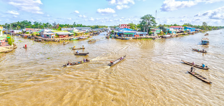 vietnamese ethnicity: Hau Giang, Vietnam - April 6th, 2015: Panorama corner floating market river boats, ships filthy beats back and forth on the river, boat ferryman, carrying agricultural products all gathered in Hau Giang, Vietnam Editorial