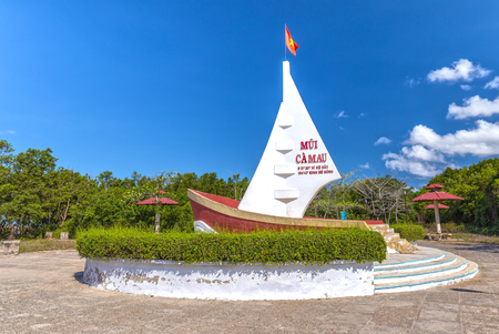 southernmost: Ca Mau, Vietnam - April 7th, 2015: Milestone Southernmost point with boat-shaped monument with sails seaward territorial claims in the region Southernmost Ca Mau, Vietnam