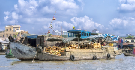 commodities: Can Tho, Vietnam - April 5th, 2015: Cai Rang floating market in the Mekong River is characteristic for the West River area very casual and rustic in business agricultural commodities in Can Tho, Vietnam Editorial