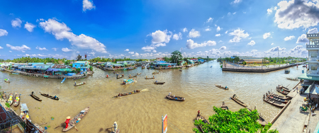 vietnamese ethnicity: Hau Giang, Vietnam - April 6, 2015: A group of business, movement of goods across the junction of the river on a sunny morning at the floating market in Hau Giang, Vietnam