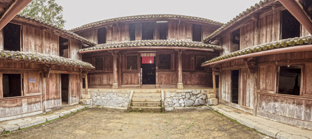 national monuments: Ha Giang, Vietnam - September 21th, 2015: Relic handmade wooden country house architecture and tile United is the state of national monuments. This is the art of architecture from the 19th century plateau in Ha Giang, Vietnam Editorial