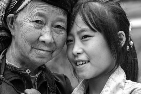 endearing: In Ha Giang, Vietnam - September 21st, 2015: The first cluster toward her nephew express love with her endearing smile and kindness in an autumn morning in the plateau of Dong Van, Ha Giang, Vietnam