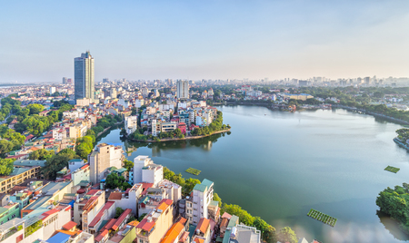 Hanoi, Vietnam, 28th September, 2015: The urban development of capital Hanoi, Vietnam with large beside lakes west skyscraper architecture as a luxury resort perfect for watching the sunset at West Lake, Hanoi, Vietnam Editorial