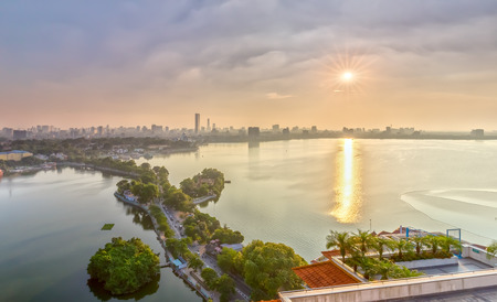 behold: Hanoi, Vietnam, 28th September, 2015: Sun star sunset west lake when afternoon sun beautiful creating stars make this place more brilliant scene to behold in Hanoi, Vietnam