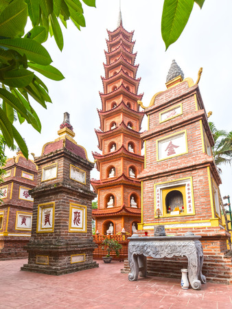 tran: Hanoi, Vietnam - September 29th, 2015: Beauty of architecture tower harkened Tran Quoc Pagoda Chinese temple architecture with red brick honoring  homage gods of support for country at Hanoi, Vietnam Editorial