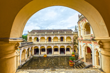 vietnamese ethnicity: Hoang A Tuong palace corner looking over arch corridor Eurasian architecture harmoniously combined in more than hundred years this architecture still stands majestic symbol of authority white plateau