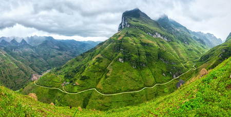 behold: Ma Pi Leng Pass Unique bow, Ha Giang, Vietnam with clouds all year round attracting majestic mountains to behold Your Soul Stock Photo