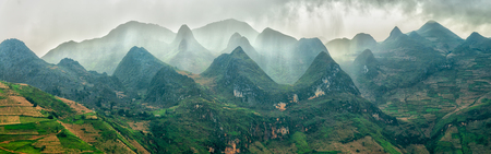 Dong Van Plateau, Ha Giang, Vietnam with limestone mountains are covered with frost heaving and the rain suddenly surrounding hills covered Came Stock Photo