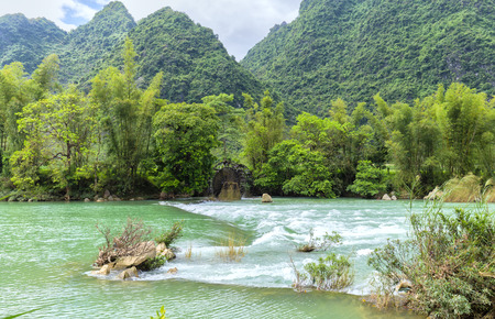 Rapids on the river with waters homeland sloped undulations. People Take Advantage Of hydroelectric power water to irrigation water for rice fields cung