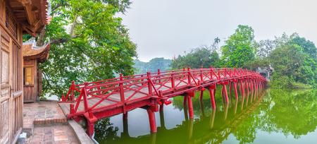 Huc Bridge spanning the Ngoc Son Temple, Hanoi, Vietnam with curved bridge architecture symbolizes red crawfish capital region Thousands of years civilization, god temple tortoises Enters Vietnam history Stock Photo