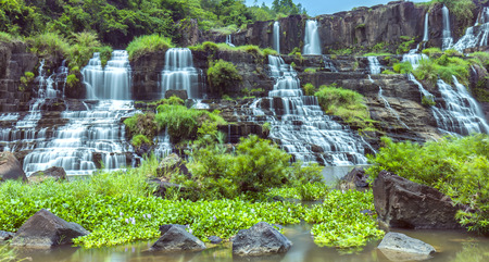 Pongour in spring with beautiful clouds and multi-story stone structure trembling under the great water Makes stone steps. It attracts a lot of tourists at home and abroad