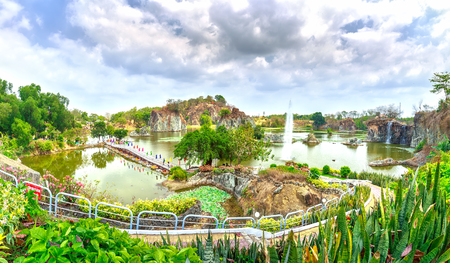interspersed: Dong Nai, Vietnam Panorama mountain lake with bridges crossing paths dragon island interspersed Vegetation rich landscape around this place more beautiful, idyllic to welcome spring in Dong Nai, Vietnam