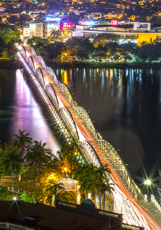 Hue, Vietnam - June 21st, 2015: architectural beauty of the Trang Tien Bridge Reflected lights shimmering on the river, the light rays forming Nocturnal beauty created in the city of Hue, Vietnam