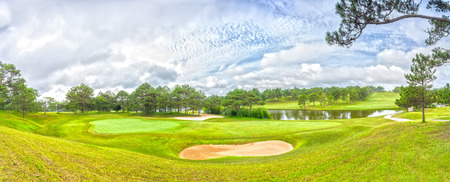 Dalat panoramic golf course with grass, pine forest, interwoven, far away from the lakes create picture to greet a new day wearing in the highlands of Dalat, Vietnam. Tourists come to this place often Do and golf resort