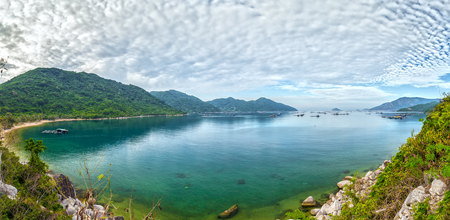 Vung Ro bay sunny day panorama with clouds drifting under water waste Reflected in the bay, fishing boats far away from the moored ... very peaceful. Stock Photo