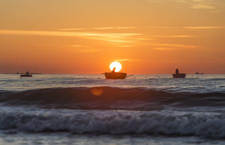 livelihoods: Quang Ngai, Vietnam, June 27, 2015: Man fishing boat near the shore in the early morning sun in the waters khi Pannier first horizontal Quang Ngai, Vietnam