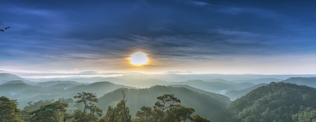 Sunrise over pine Dalat plateau khi sun rays radiating Rises on hill plateau of morning mist making Began waking to a new day is beautiful Stock Photo