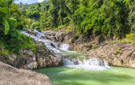 overflows: Lunch Yangbay spring panoramic rapids cascade flowing down the valley with the forest from the lake overflows Into great natural beauty to create mountains of Khanh Hoa, Vietnam