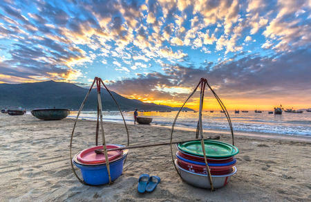 Da Nang, Vietnam, June 26th, 2015: Double strickle, slippers expected to welcome the new day afar who Came back, this is the vehicle for trafficking Fishermen fish in waters over simple, rustic but rich emotional meaning of life Stock Photo