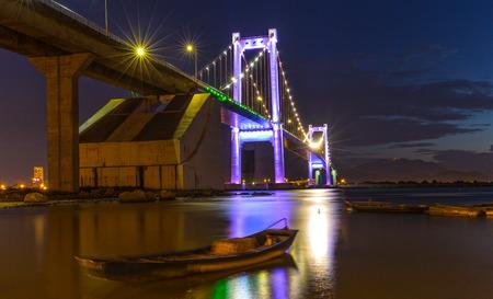 Da Nang, Vietnam - June 25th, 2015: Beauty Thuan Phuoc Bridge architecture with glowing lights inside marina rays shining down river Carried reliability in Da Nang, Vietnam