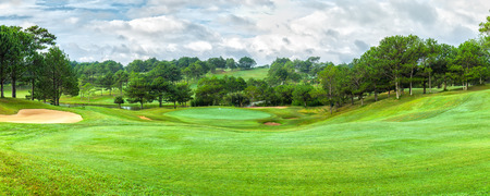 Dalat golf panorama sunny day with pine forests, vast lawns around the hill to create beauty khi watching, golfing