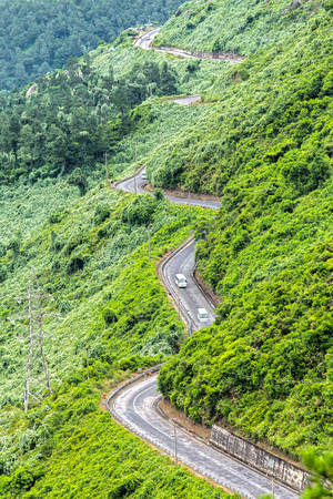 Hai Van Pass road with the same street as the snake winding around the spectacular beauty of nature t?o mountain in central Vietnam. Stock Photo
