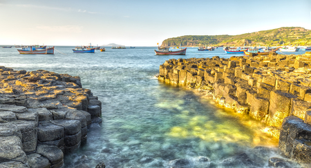 Exposure Giants Causeway waves at dawn, fishing boats are still awake. Giants Causeway is the state as a national scenic spots nh?n Stock Photo